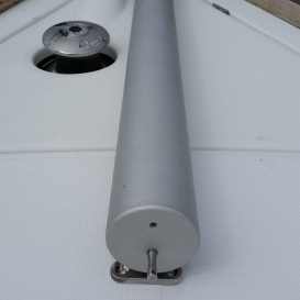 Aft end of pole mounted on folding pad eye with locking pin